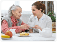 caretaker preparing meal for her patient