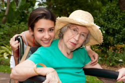 caregiver caring an elderly woman