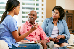 nurse talking to an elderly couple