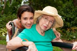 caregiver caring an elderly woman
