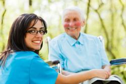 nurse and elderly man smiling